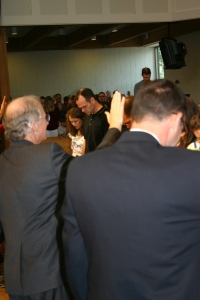 Pastor John Piper praying during our commisioning service